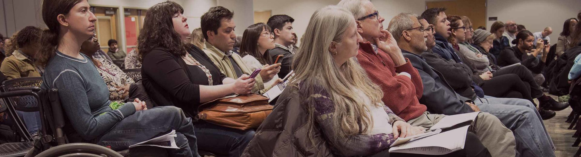 a mixed ability audience sits in a conference room