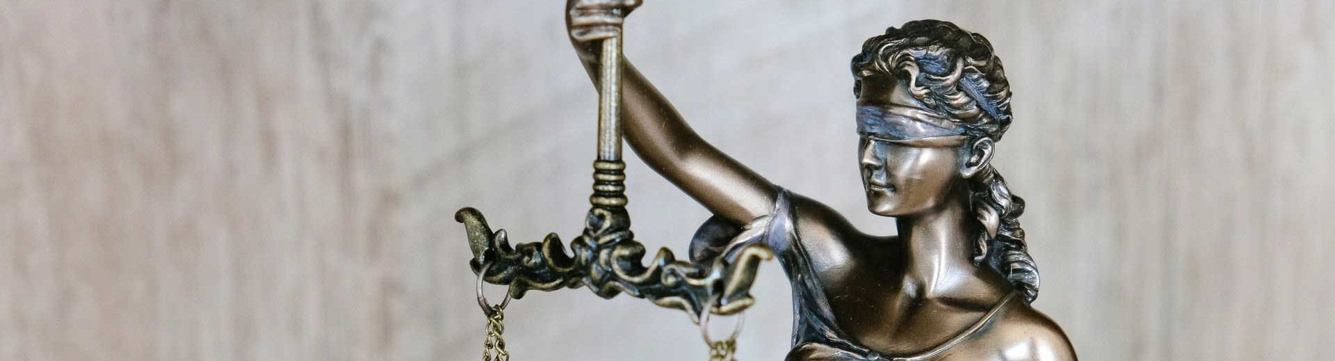 Cast metal figure of Lady Justice holding scales